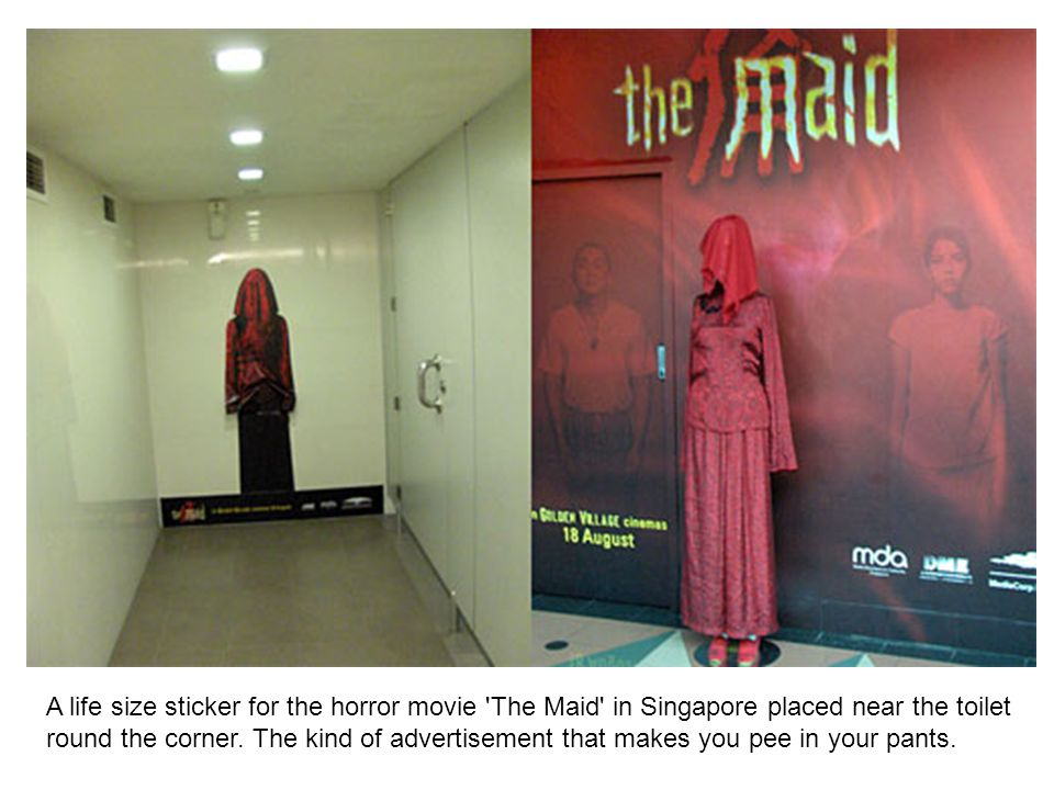 A life size sticker for the horror movie The Maid in Singapore placed near the toilet round the corner.