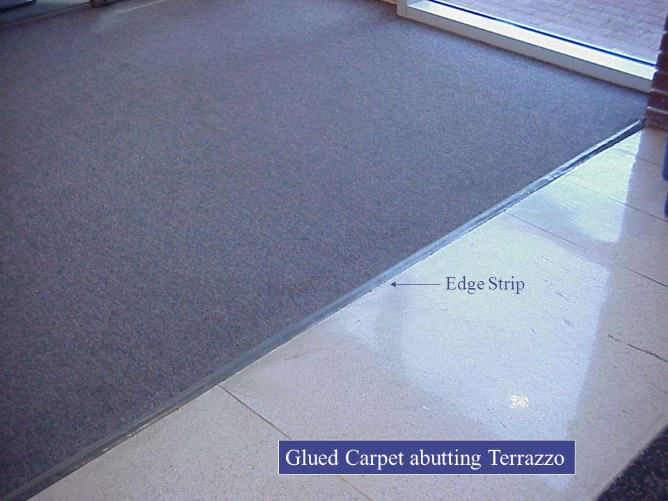 Glued Carpet abutting Terrazzo