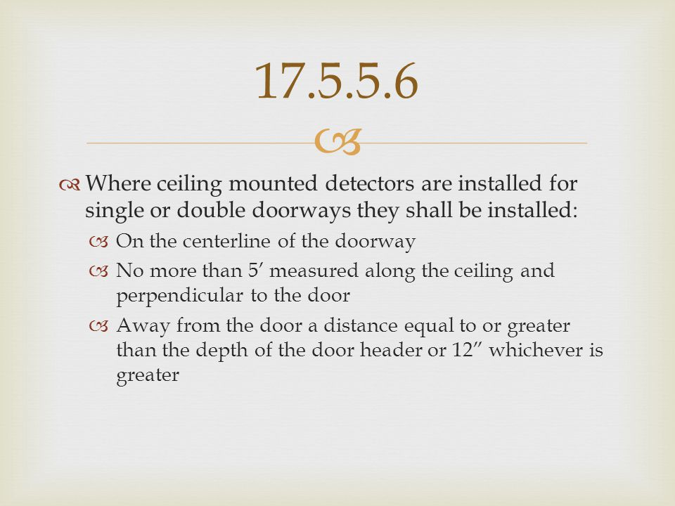 17.5.5.6 Where ceiling mounted detectors are installed for single or double doorways they shall be installed: