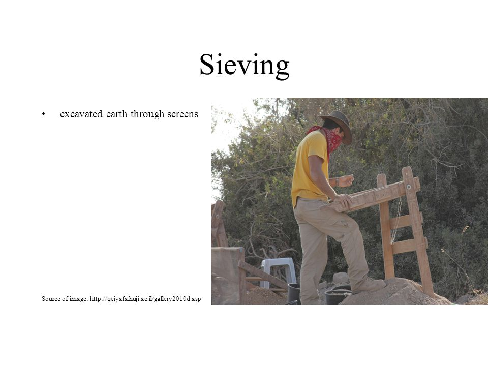 Sieving excavated earth through screens