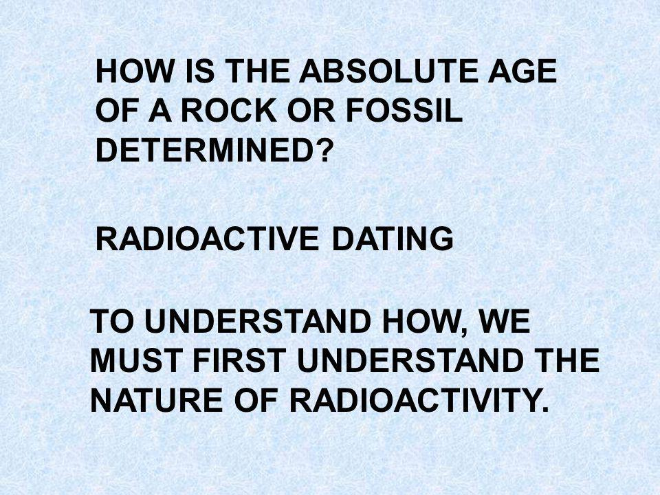 HOW IS THE ABSOLUTE AGE OF A ROCK OR FOSSIL DETERMINED