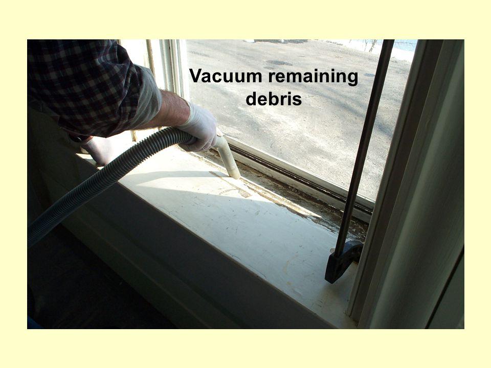 Vacuum remaining debris