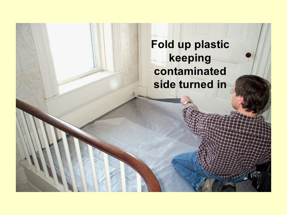 Fold up plastic keeping contaminated side turned in