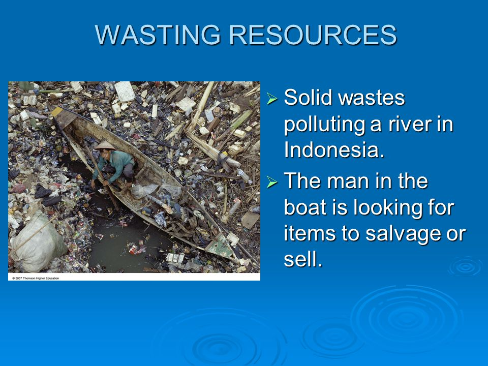 WASTING RESOURCES Solid wastes polluting a river in Indonesia.