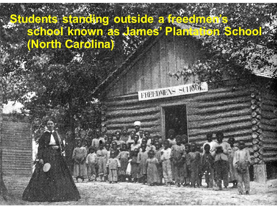 Students standing outside a freedmen's school known as James' Plantation School (North Carolina)