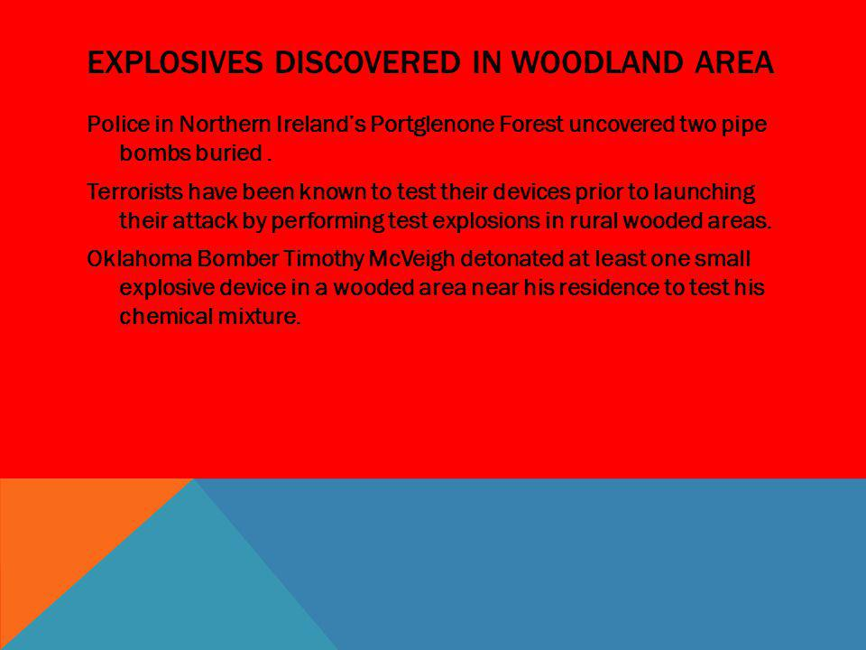 Explosives discovered in woodland area