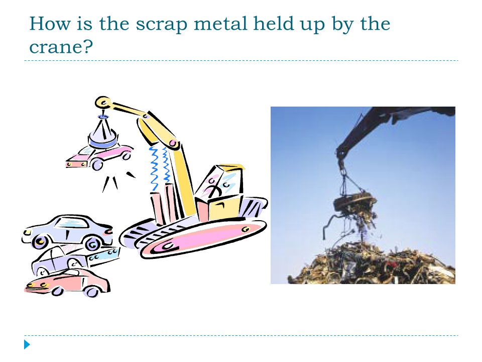 How is the scrap metal held up by the crane