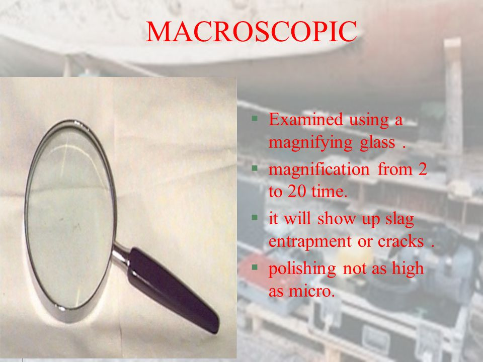 MACROSCOPIC Examined using a magnifying glass .
