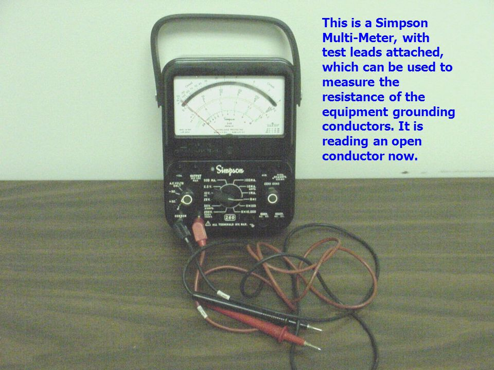 This is a Simpson Multi-Meter, with test leads attached, which can be used to measure the resistance of the equipment grounding conductors.