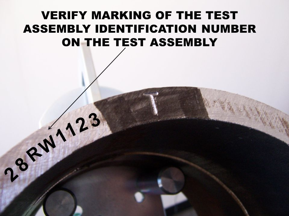 VERIFY MARKING OF THE TEST ASSEMBLY IDENTIFICATION NUMBER ON THE TEST ASSEMBLY