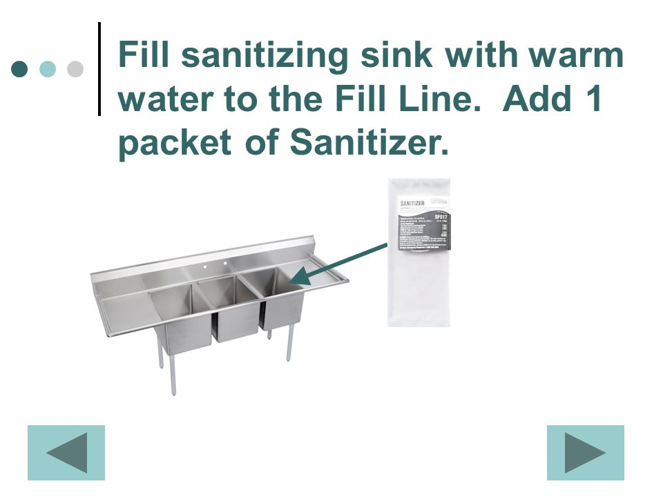 Fill sanitizing sink with warm water to the Fill Line