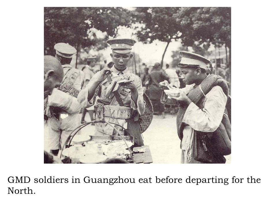 GMD soldiers in Guangzhou eat before departing for the North.