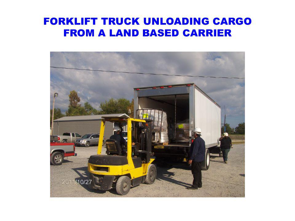 FORKLIFT TRUCK UNLOADING CARGO FROM A LAND BASED CARRIER