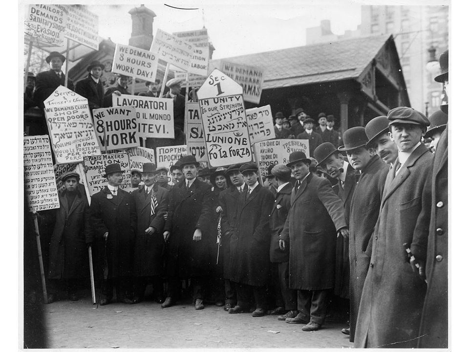 fig18_19.jpg Page 695: Striking New York City garment workers carrying signs in multiple languages, 1913.