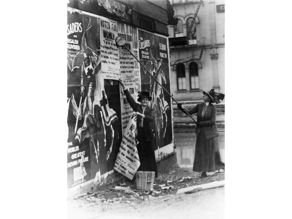 fig18_28.jpg Page 707: Two well-dressed Cincinnati women putting up a poster for women's suffrage, 1912.