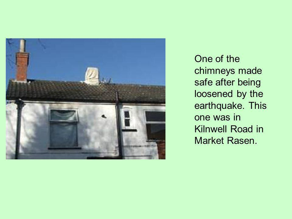 One of the chimneys made safe after being loosened by the earthquake