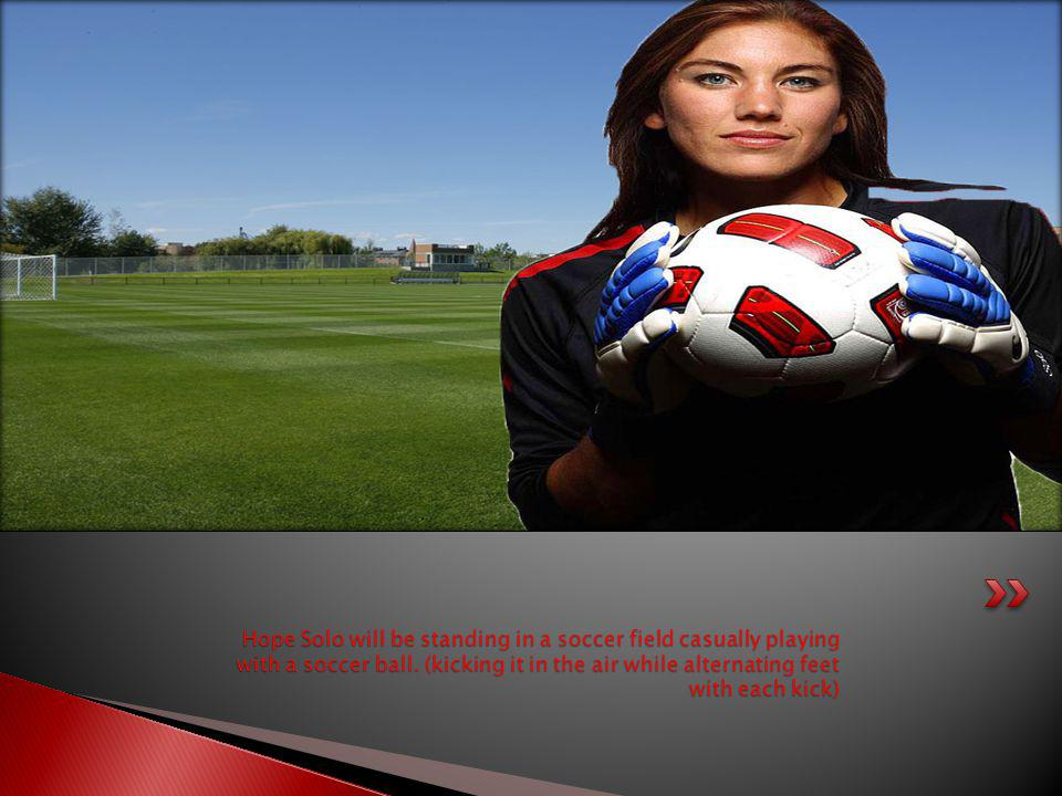 Hope Solo will be standing in a soccer field casually playing with a soccer ball.