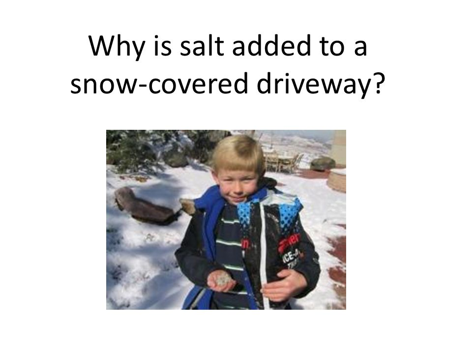 Why is salt added to a snow-covered driveway