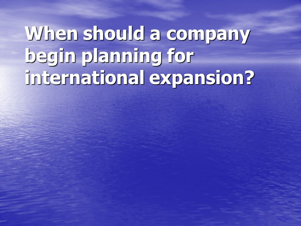 When should a company begin planning for international expansion