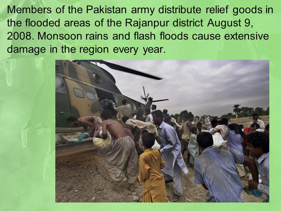 Members of the Pakistan army distribute relief goods in the flooded areas of the Rajanpur district August 9, 2008.
