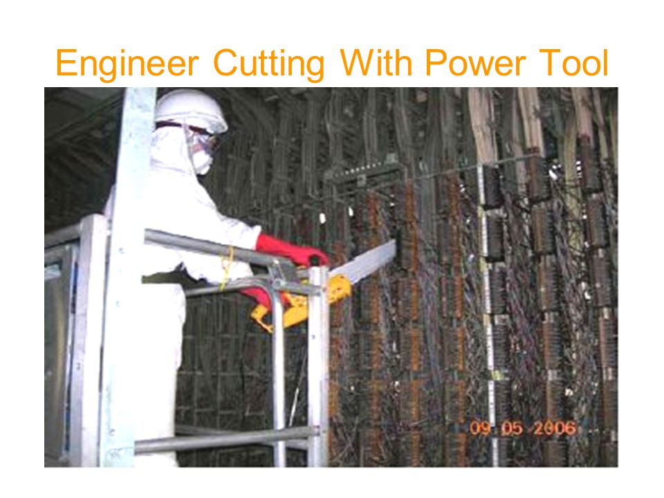 Engineer Cutting With Power Tool
