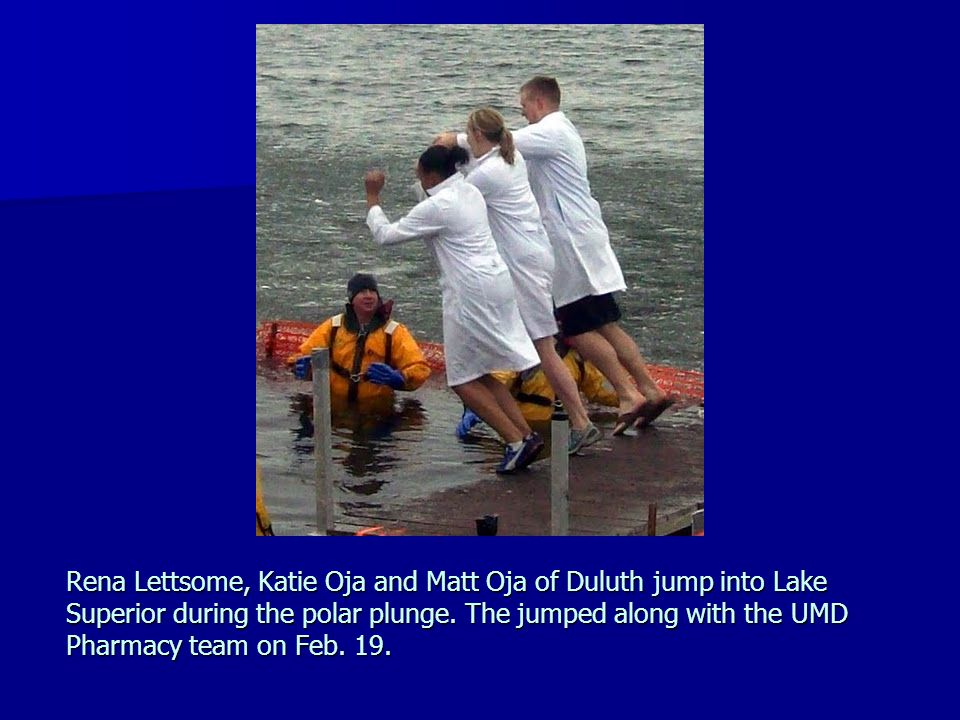 Rena Lettsome, Katie Oja and Matt Oja of Duluth jump into Lake Superior during the polar plunge.