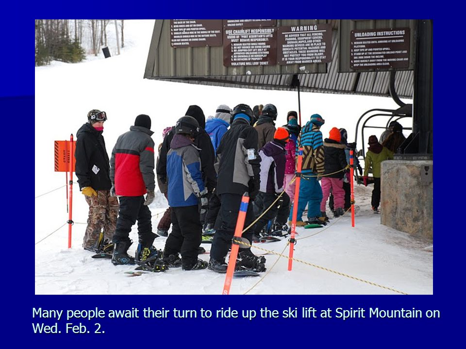 Many people await their turn to ride up the ski lift at Spirit Mountain on Wed. Feb. 2.