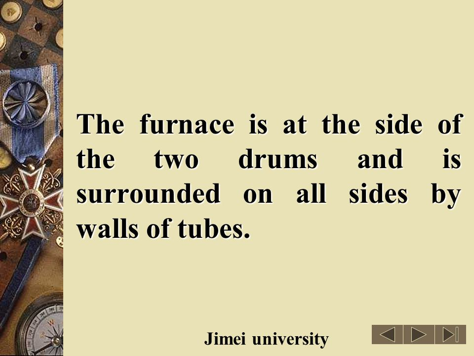 The furnace is at the side of the two drums and is surrounded on all sides by walls of tubes.