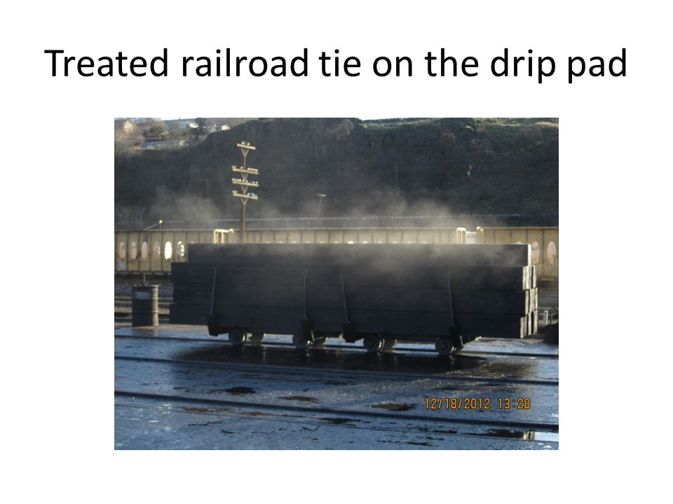 Treated railroad tie on the drip pad