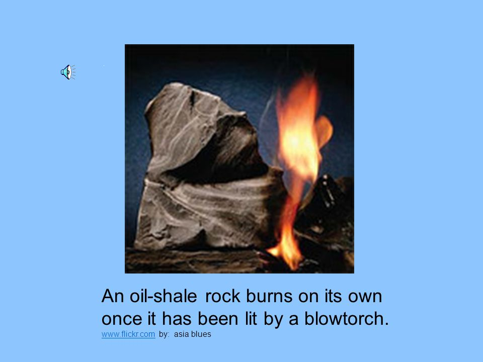 An oil-shale rock burns on its own once it has been lit by a blowtorch.