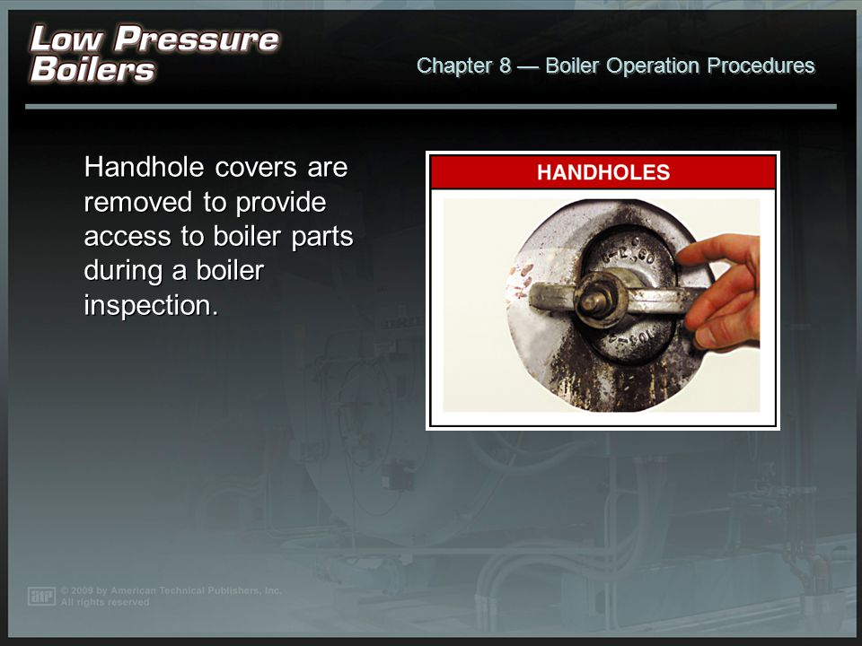 Handhole covers are removed to provide access to boiler parts during a boiler inspection.