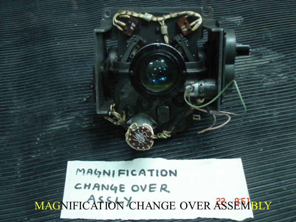 MAGNIFICATION CHANGE OVER ASSEMBLY