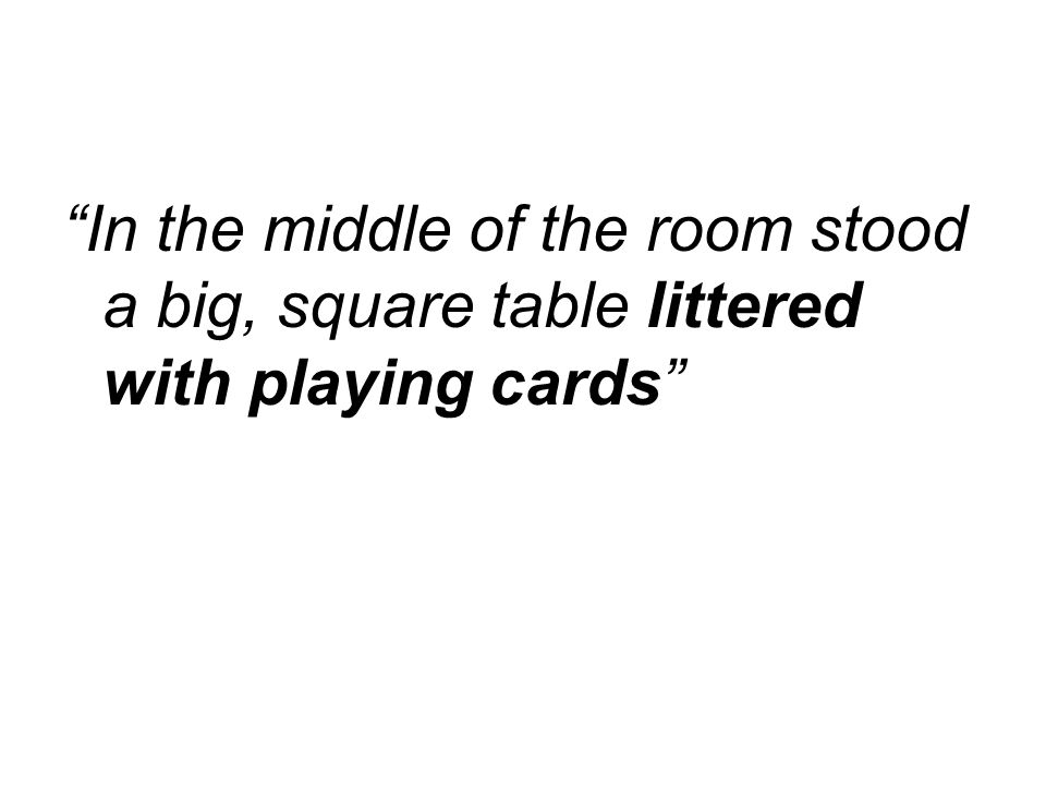 In the middle of the room stood a big, square table littered with playing cards