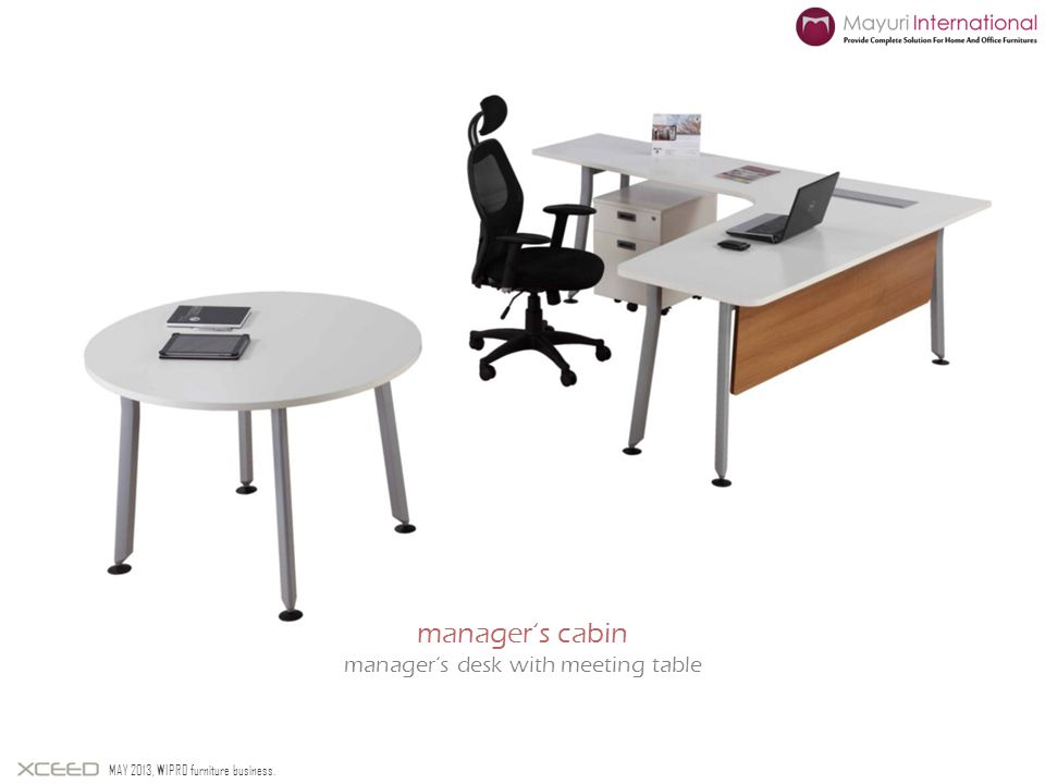 manager's desk with meeting table