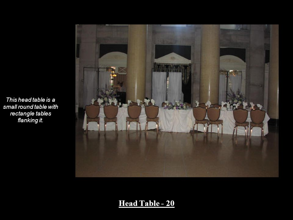 This head table is a small round table with rectangle tables flanking it.
