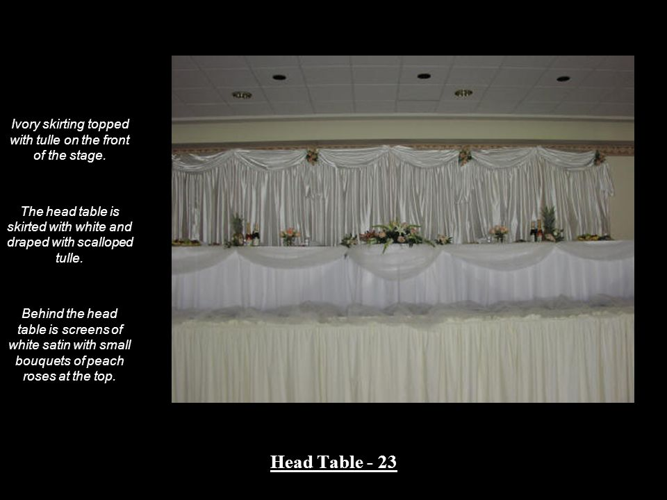 Ivory skirting topped with tulle on the front of the stage.