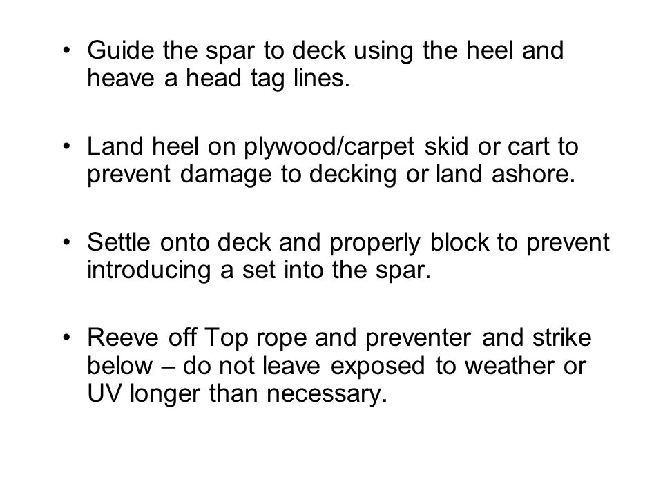 Guide the spar to deck using the heel and heave a head tag lines.