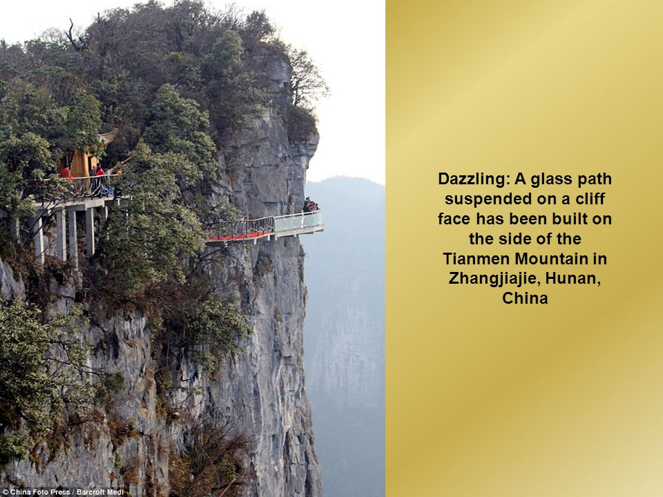 Dazzling: A glass path suspended on a cliff face has been built on the side of the Tianmen Mountain in Zhangjiajie, Hunan, China