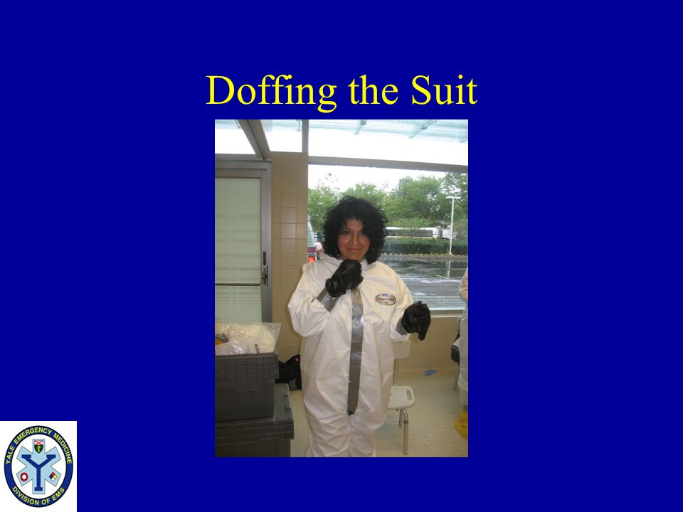 Doffing the Suit Once the PAPR is removed Pull the tape covering the front zipper