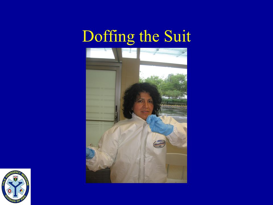 Doffing the Suit Once the tape and the outer gloves are off reach inside to pull the zipper apart. Make sure you do not touch the outside.