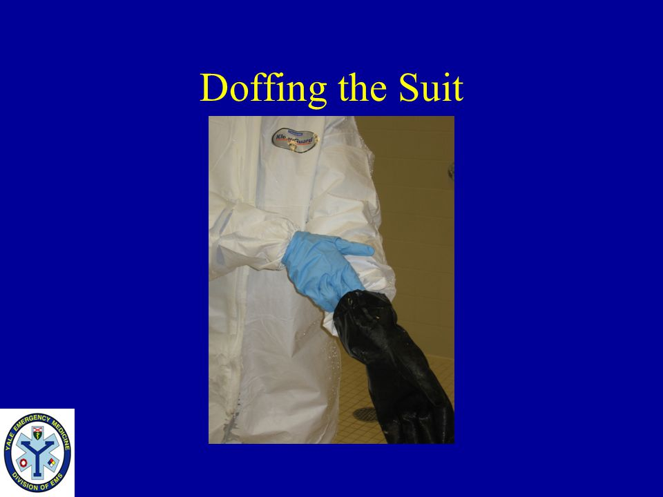 Doffing the Suit Take your clean inner glove and slide it under the outer glove and remove it taking care not to touch the outer glove.