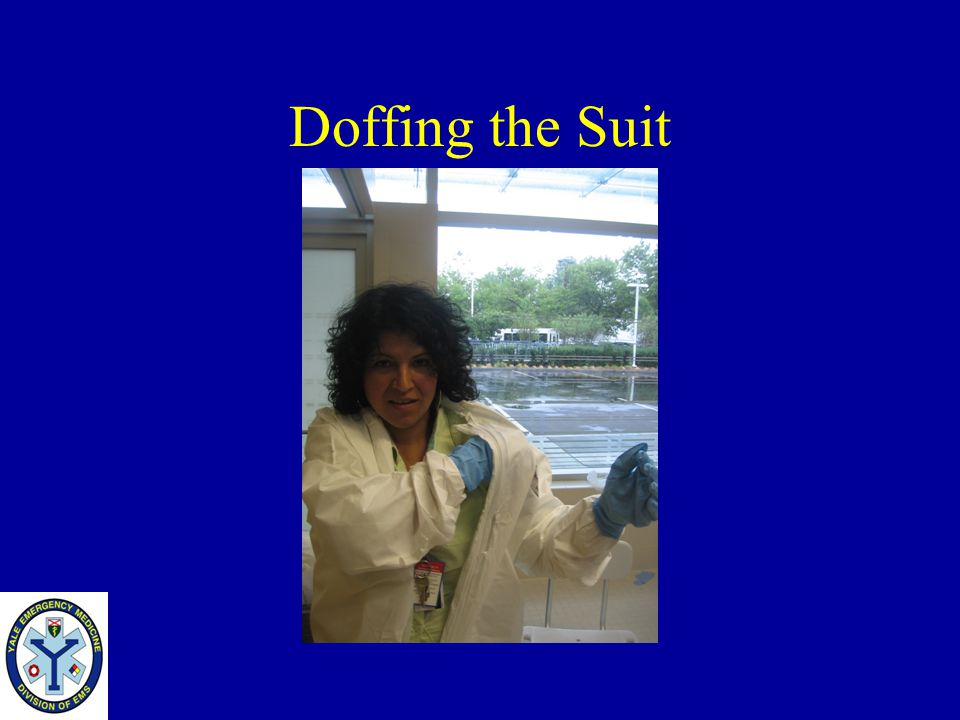 Doffing the Suit Reach into the suit and pull the arm out