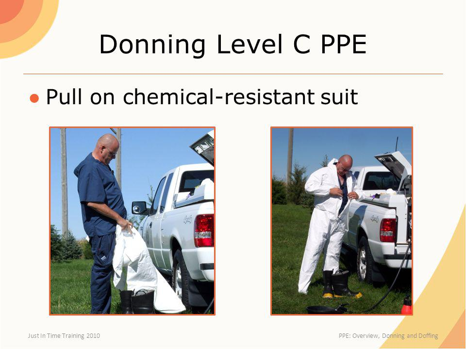 Donning Level C PPE Pull on chemical-resistant suit