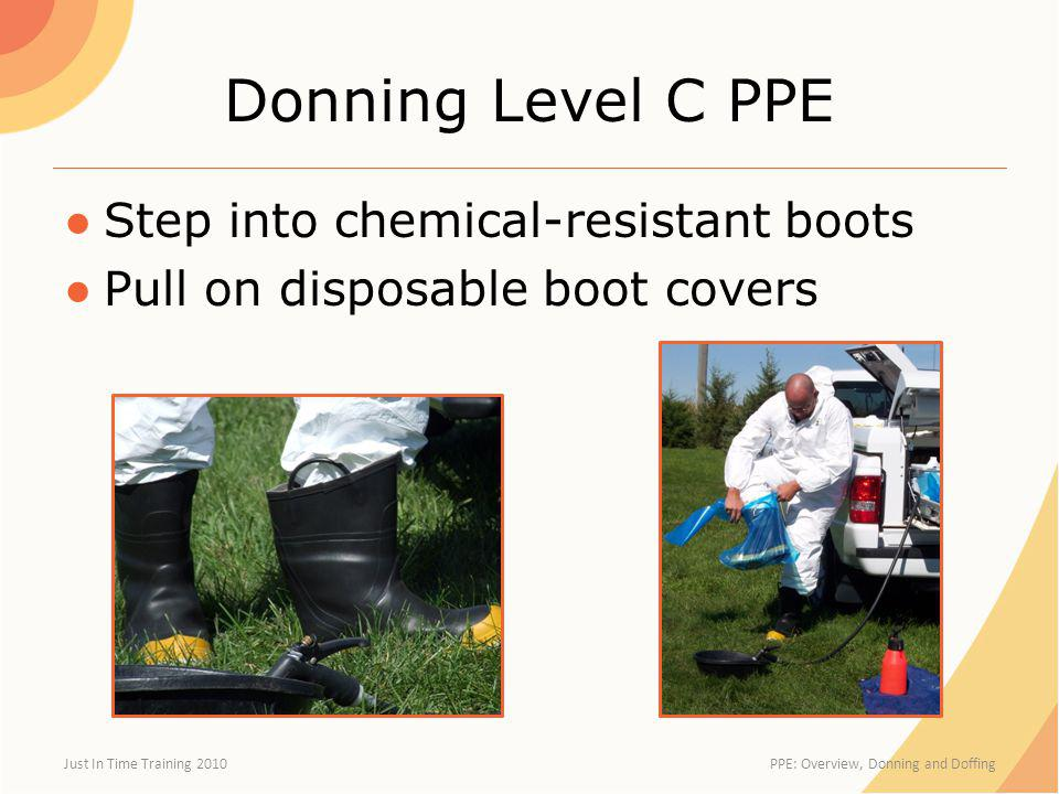 Donning Level C PPE Step into chemical-resistant boots