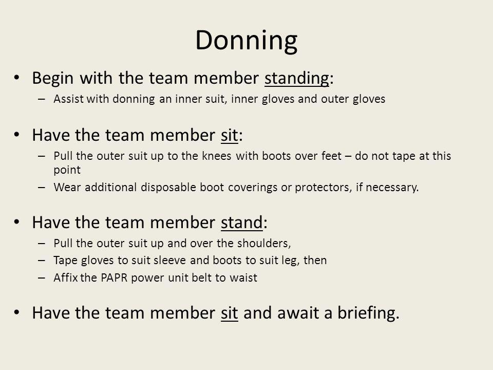 Donning Begin with the team member standing: Have the team member sit: