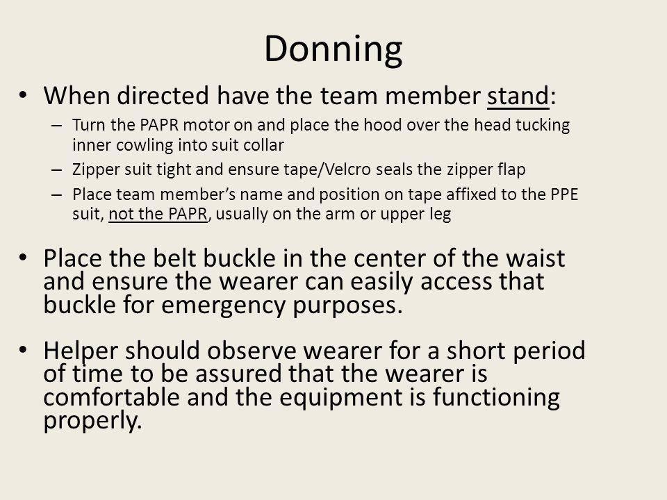 Donning When directed have the team member stand: