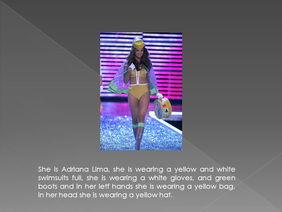 She is Adriana Lima, she is wearing a yellow and white swimsuits full, she is wearing a white gloves, and green boots and in her letf hands she is wearing a yellow bag, in her head she is wearing a yellow hat.
