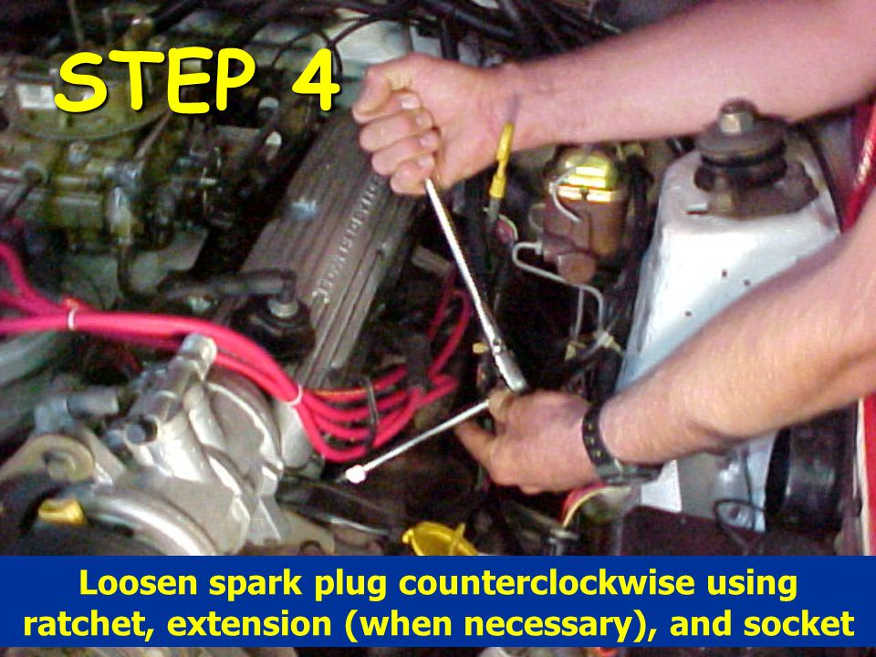 STEP 4 Loosen spark plug counterclockwise using ratchet, extension (when necessary), and socket