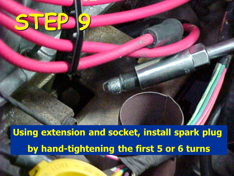 STEP 9 Using extension and socket, install spark plug