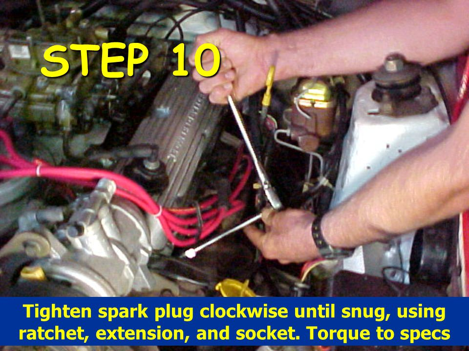 STEP 10 Tighten spark plug clockwise until snug, using ratchet, extension, and socket.